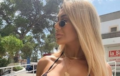 Cheeky Chloe Ferry strips down to a thong for late-night walk around Ibiza