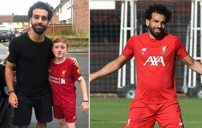Mohamed Salah stops to take photo after a young fan is knocked out