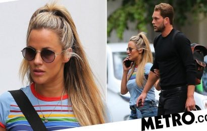 Caroline Flack clings on to beau Lewis Barton as his ex warns her off