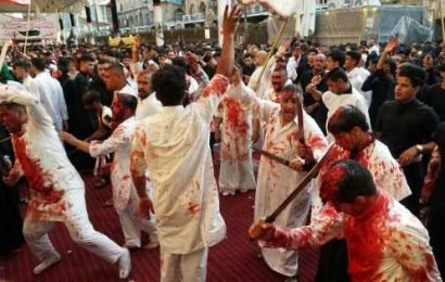 Devout Muslims slice open their heads with swords during annual ritual