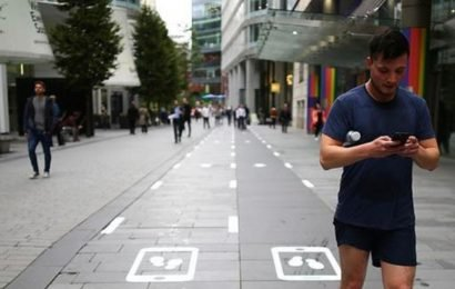 Manchester opens UK's first slow lane for people looking at phones while walking