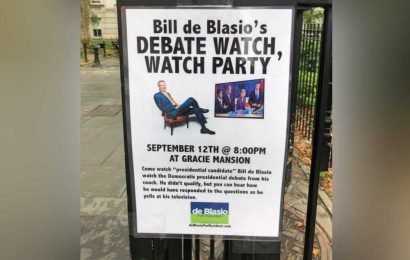 Signs for de Blasio's debate 'watch, watch party' put up outside City Hall