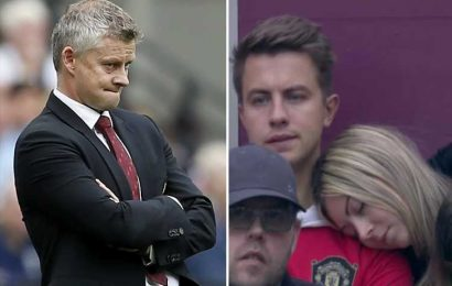 Man Utd fan's bored girlfriend falls asleep on his shoulder during clash against West Ham – The Sun