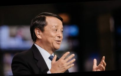 Hong Kong bourse chief takes rare swipe at 'one country, two systems' setup