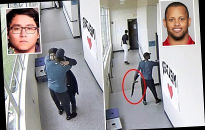Heroic moment school football coach disarms and HUGS shotgun-toting student who wanted to kill himself in class