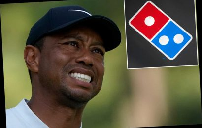 Tiger Woods gets stuck at Domino's Pizza in Japan