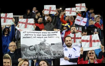 Kosovo fans wave St George flags during God Save the Queen in stunning show of support for England – The Sun