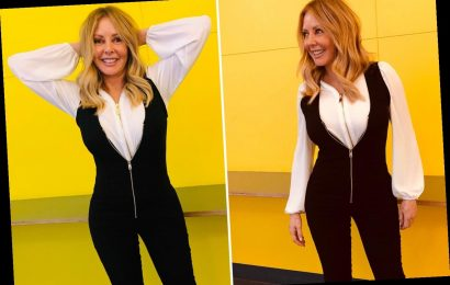 Carol Vorderman shows off her killer curves as she strikes a pose in Wales