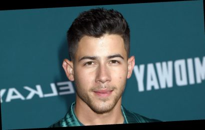 Nick Jonas Sports Silk, Teal Suit for 'Midway' Premiere