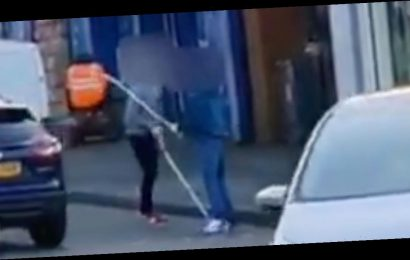 Two men filmed attacking each other with crutches in city centre brawl