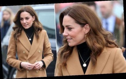 Kate Middleton mixes high street and high end in Zara skirt & Ralph Lauren boots today