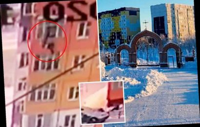 Woman SURVIVES 90ft fall from Russian tower block and even stands up and walks away after landing in thick snow – The Sun