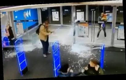 Shopper pushes open store doors so hard that they smash to smithereens