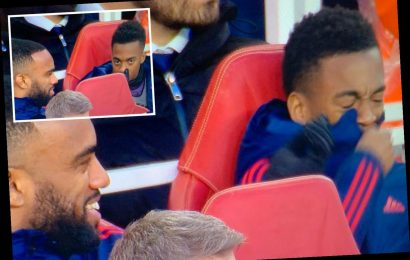 Fans bemused by bizarre moment Lacazette gets Arsenal pal Willock to sniff his fingers as TV cameras turn to bench – The Sun
