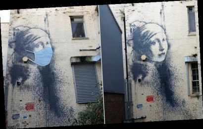 Banksy's Girl with a Pierced Eardrum is given a Covid-19 face mask