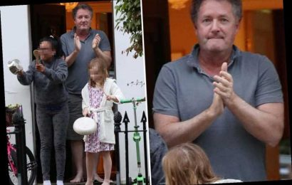 Piers Morgan takes to his doorstep with daughter Elise to clap for carers as he continues to recover from illness