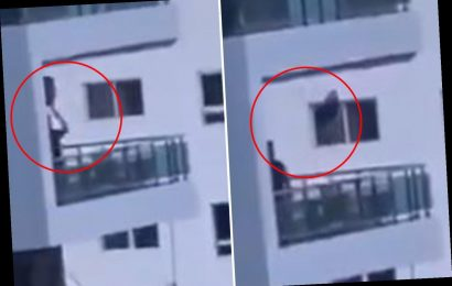 Dad spotted pushing toddler on balcony swing 80ft off the ground in absolutely heartstopping footage – The Sun