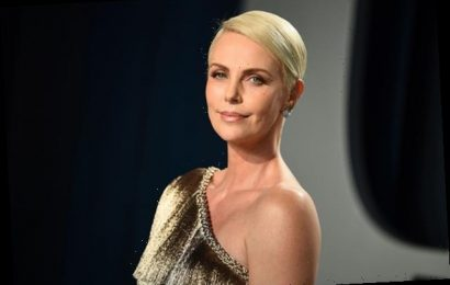 Charlize Theron Cuddles Daughter Jackson In Rare, Intimate Photo From 'Mad Max' Set