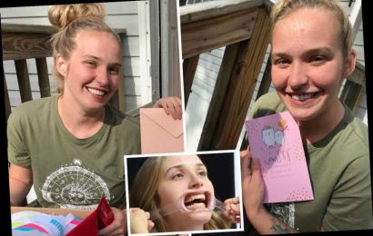 Mama June's daughter Anna, 25, shows off blinding white new veneers while hugging her kids