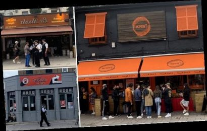Police break up drinkers enjoying a pint outside a bar in London