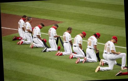 Giants And Dodgers Players Take A Knee During National Anthem