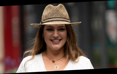 Kelly Brook dazzles in white dress and fedora after revealing cruel trolls branded her 'unsexy'