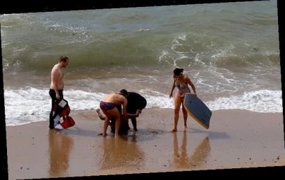 Rescuers drag drowning man from the sea