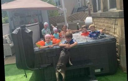 Britain's biggest family the Radfords unwind in their hot tub during the heatwave – and they cram in 6 of their 22 kids