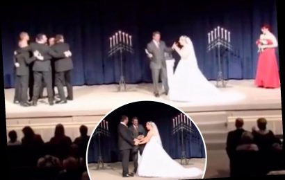 'Tacky' groom blasted for leaving his bride to chat to his groomsmen MID wedding vows