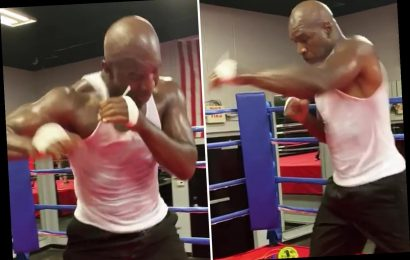 Evander Holyfield looks in stunning shape but 57-year-old showing his age with slow hand speed as he trains for return