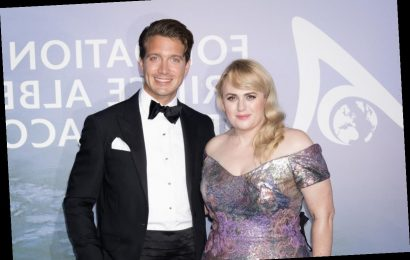 Rebel Wilson & Jacob Busch's Red Carpet Body Language Is Complicated
