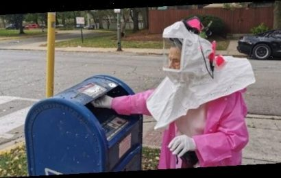 102-year-old suits up hazmat style to mail her ballot