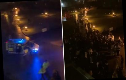 Cops break up street party as 100 students dance and push each other around in shopping trolleys at Warwick University