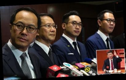 Four Hong Kong democrat politicians removed from power under new law