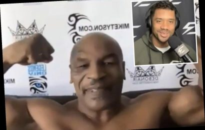 Watch Mike Tyson rip off shirt to show ripped physique as he interrupts interview with NFL quarterback Russell Wilson