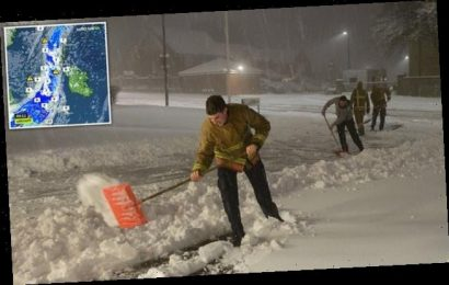 Britons wake up to snow with nearly a FOOT more set to fall today