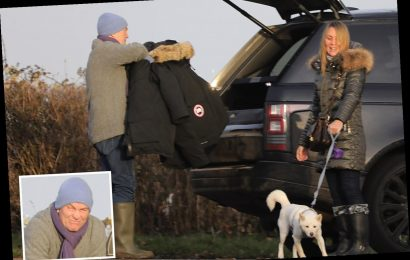 The Chase's Bradley Walsh wraps up warm for a winter walk with his wife