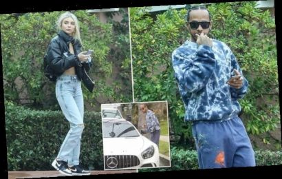 Lewis Hamilton leaves his hotel cabana  after an attractive blonde