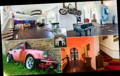 Church conversion with cars hanging from its walls is for sale