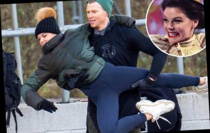 Dancing On Ice's Faye Brookes wraps her legs around partner Hamish as they practice in the snow