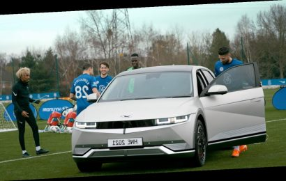 Watch Chelsea stars face dozens of footballs launched at them by machine powered by electric car
