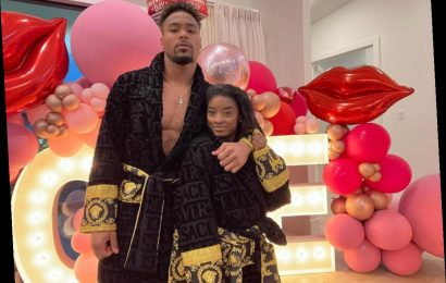 Simone Biles and Boyfriend Cozy Up in Robes in Photo After Her Birthday: 'Versace on the Floor'