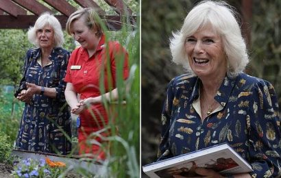 Camilla helps to plant a shrub at Whittington Hospital garden