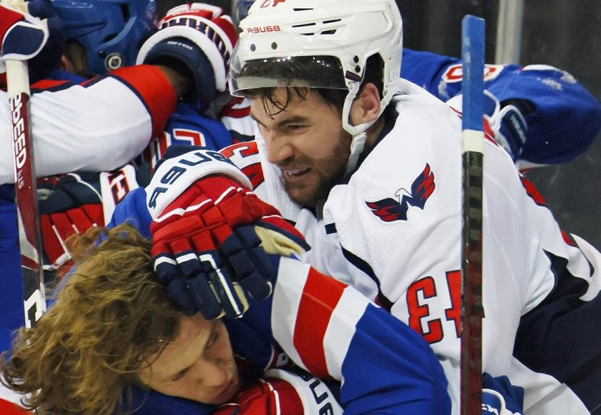 Capitals star Tom Wilson BODY SLAMS Rangers player and 'crosses the line' in wild NHL brawl