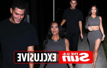 Kim Kardashian stuns in crop top and thigh-high sandals arriving at billionaire bachelor Jamie Reuben's birthday party