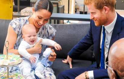 Archie 'adores baby sister Lilibet' and has been giving her 'lots of kisses' as Meghan Markle returns home from hospital