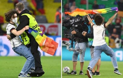 Pitch invader crashes Germany vs Hungary carrying pride rainbow after controversial Uefa ban