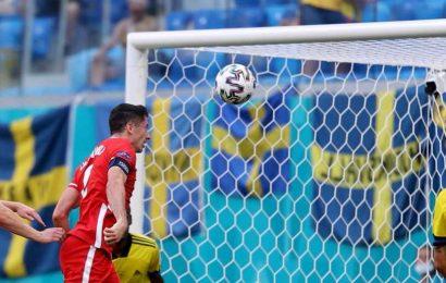 Watch Robert Lewandowski miss open goal from TWO YARDS out as Poland superstar rattles bar TWICE vs Sweden
