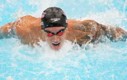 Caeleb Dressel won the men's 100-meter butterfly, setting a world record.