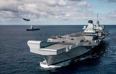Royal Navy turns tables on Putin's subs stalking Brit aircraft carrier as helicopters scrambled to drive them away